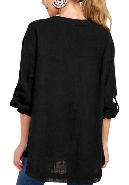Back view of model wearing black V-neckline roll-tab sleeves loose tunic top