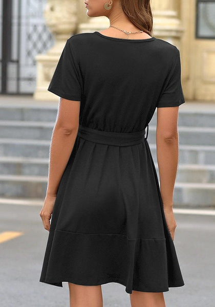Back view of model wearing black V-neckline short sleeves belted ruffle dress