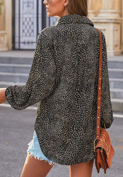Back view of model wearing black balloon sleeves collar V-neckline leopard-print top