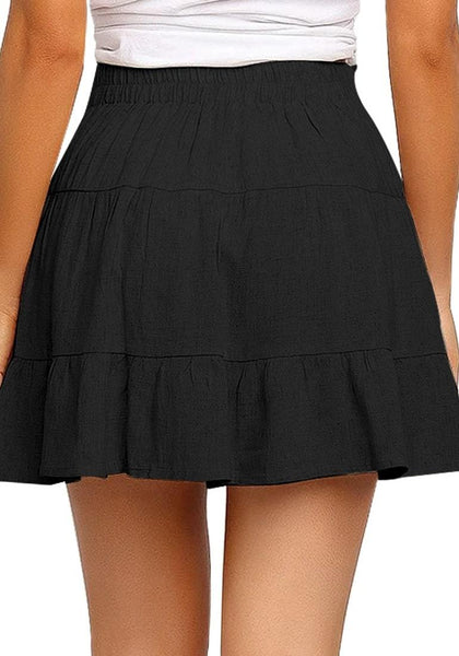 Back view of model wearing black button-front elastic-back ruffled mini skater skirt