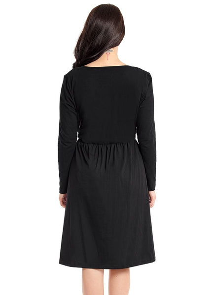 Back view of model wearing black button-front long sleeves skater dress