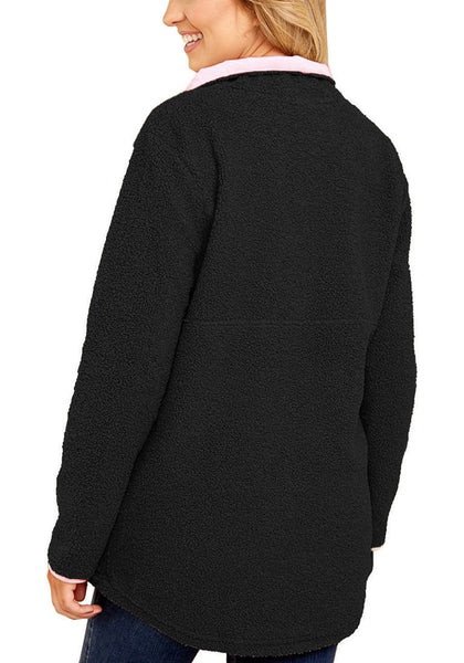Back view of model wearing black button-front pullover