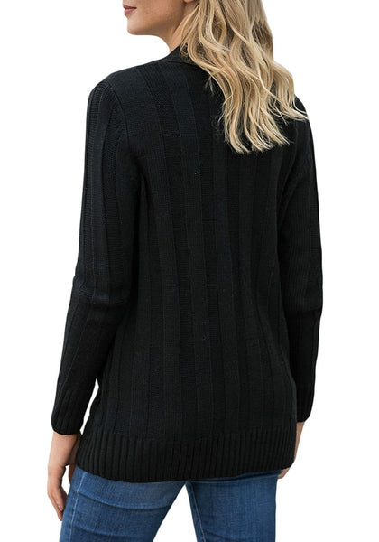 Back view of model wearing black button-up cable knit sweater cardigan
