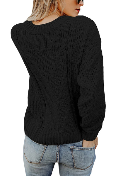 Back view of model wearing black crew neck velvet cable knit pullover sweater