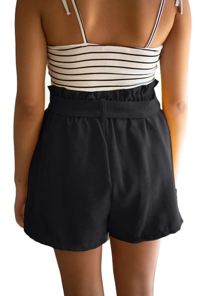 Back view of model wearing black elastic-waist buttons tie-front shorts