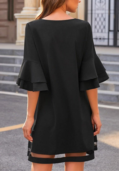 Back view of model wearing black flare sleeves mesh panel V-neckline shift dress