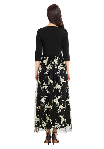 Back view of model wearing black floral-embroidered mesh maxi dress