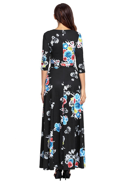 Back view of model wearing black floral print boho long faux wrap dress