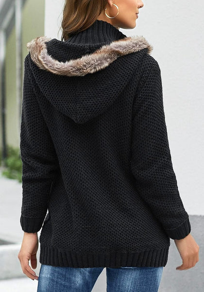 Back view of model wearing black fur hooded collar button-up cable knit cardigan