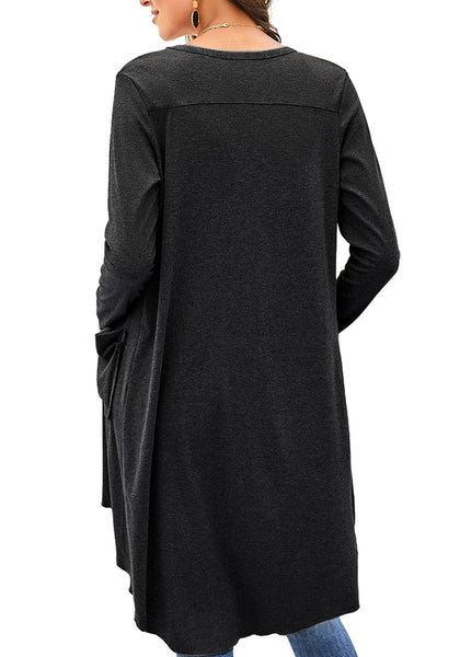Back view of model wearing black high-low button-up long knit cardigan