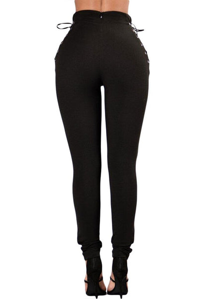 Back view of model wearing black lace-up sides grommet leggings