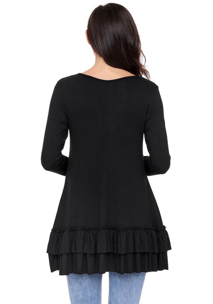 Back view of model wearing black layered ruffle-hem long sleeves tunic