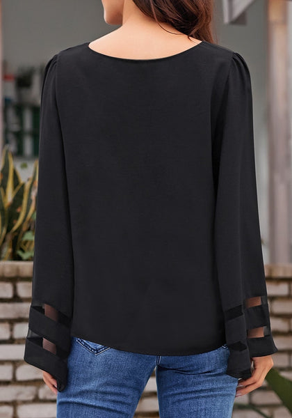 Back view of model wearing black long bell mesh panel sleeves crew neck loose top