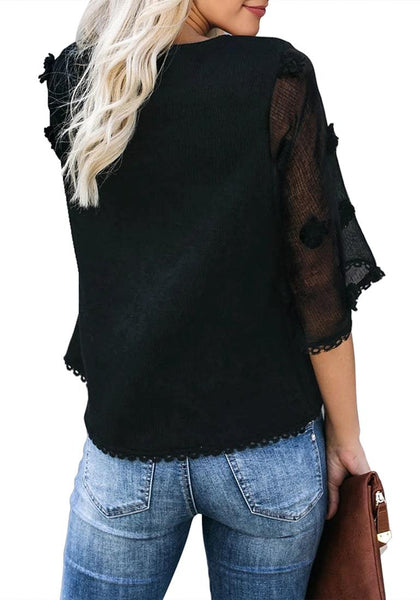 Back view of model wearing black mesh floral bell sleeves lace trim loose top