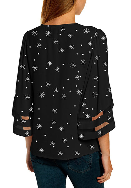 Back view of model wearing black mesh panel sleeves V-neckline Christmas-print loose top