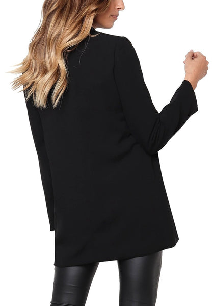 Back view of model wearing black mock-pocket double-breasted lapel blazer