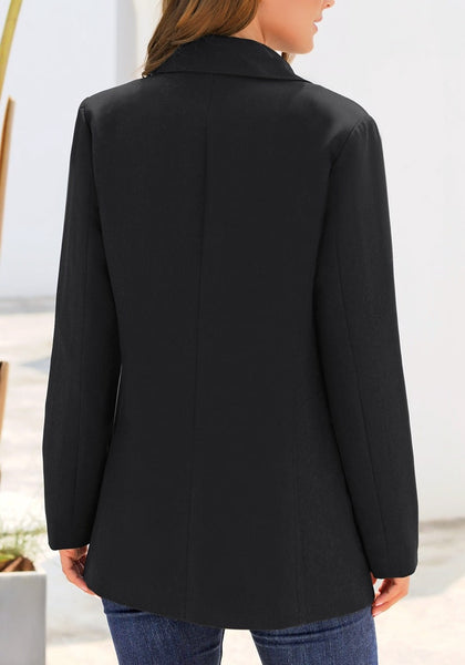 Back view of model wearing black oversized pockets double-breasted blazer