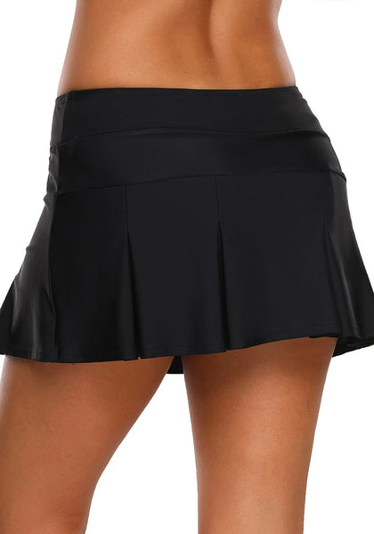 Back view of model wearing black pleated mid-waist skirt