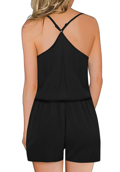 Back view of model wearing black racerback spaghetti strap button-up romper