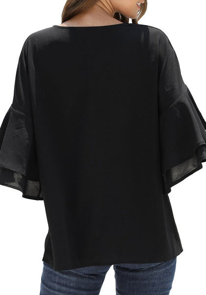 Back view of model wearing black ruffle half sleeves button-up tie-front loose top
