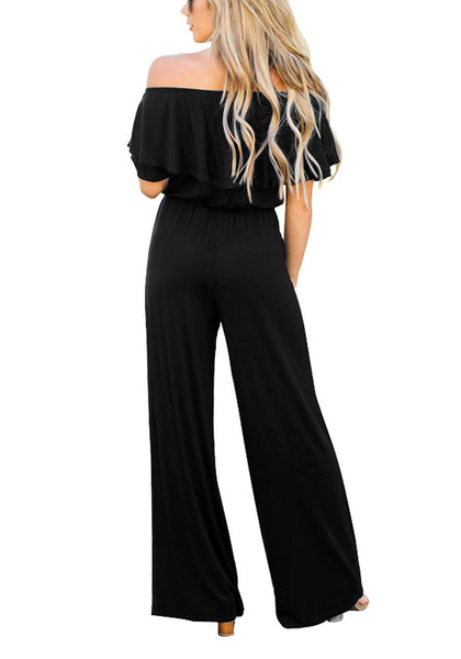 Back view of model wearing black ruffled off-shoulder jumpsuit