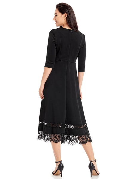 Back view of model wearing black scallop hem lace panel skater dress