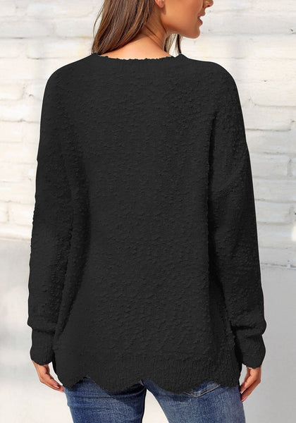 Back view of model wearing black scalloped hem fleece knit pullover sweater