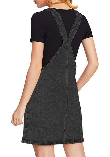 Back view of model wearing black side pockets overall denim pinafore dress