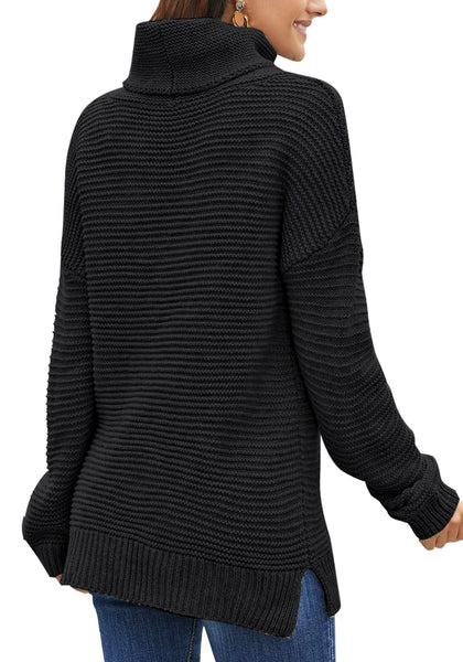 Back view of model wearing black side slit turtleneck textured knit sweater