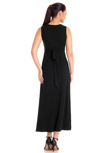 Back view of model wearing black sleeveless A-line long maternity dress
