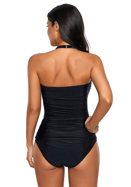 Back view of model wearing black sweetheart neckline halter ruched tankini set