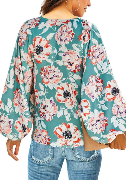 Back view of model wearing blue V-neckline balloon sleeve floral blouse