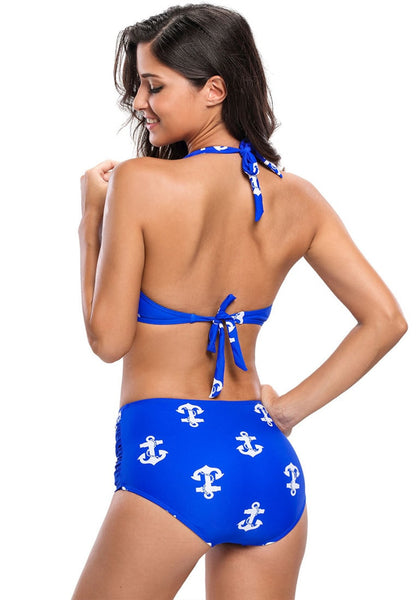 Back view of model wearing blue anchors halter bikini set