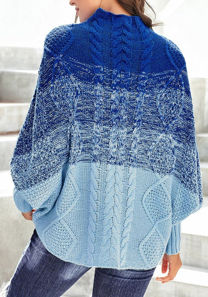 Back view of model wearing blue batwing sleeves ombre turtleneck cable knit sweater