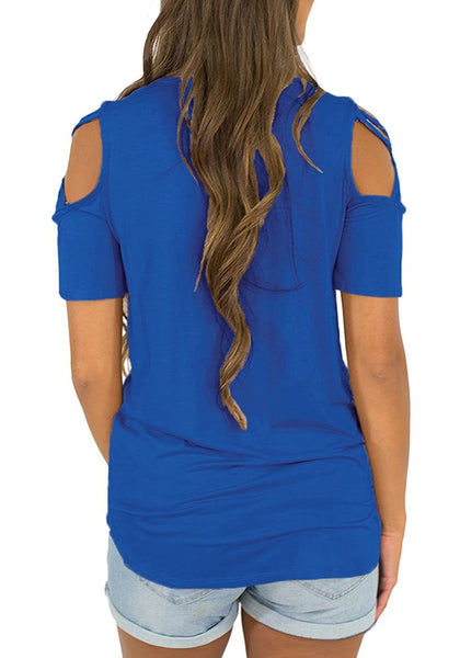 Back view of model wearing blue crisscross cutout shoulder blouse