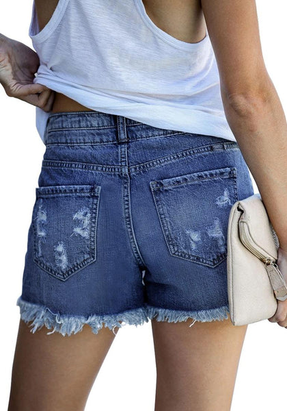 Back view of model wearing blue double button raw hem ripped jeans shorts