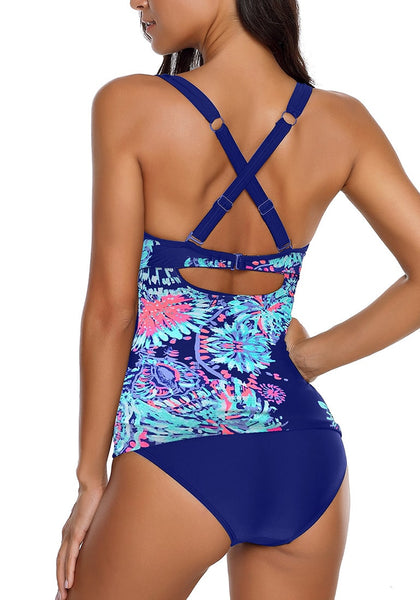 Back view of model wearing blue floral print sweetheart faux wrap tankini set