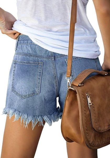 Back view of model wearing blue frayed hem washed denim jeans shorts