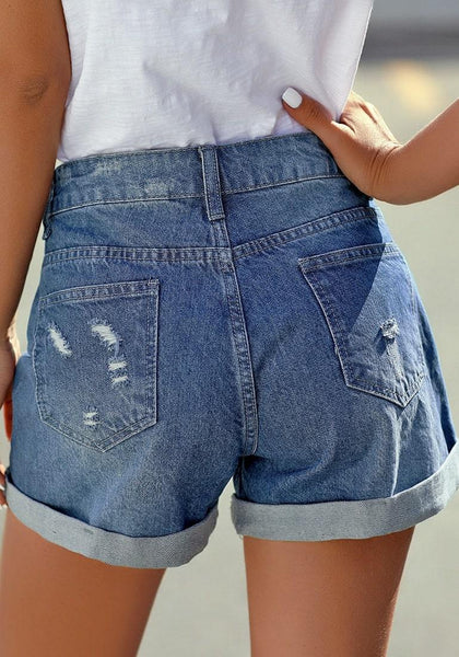 Back view of model wearing blue roll-over distressed denim shorts