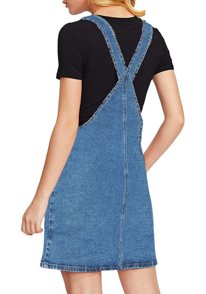 Back view of model wearing blue side pockets overall denim pinafore dress