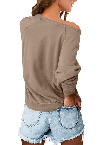 Back view of model wearing brown french terry crewneck pullover sweatshirt