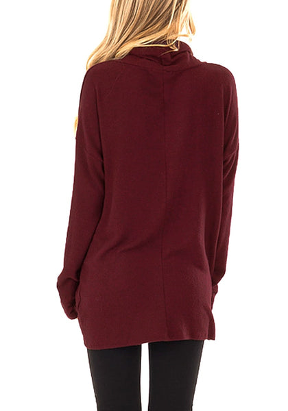Back view of model wearing burgundy cowl neck side twist knot tunic top
