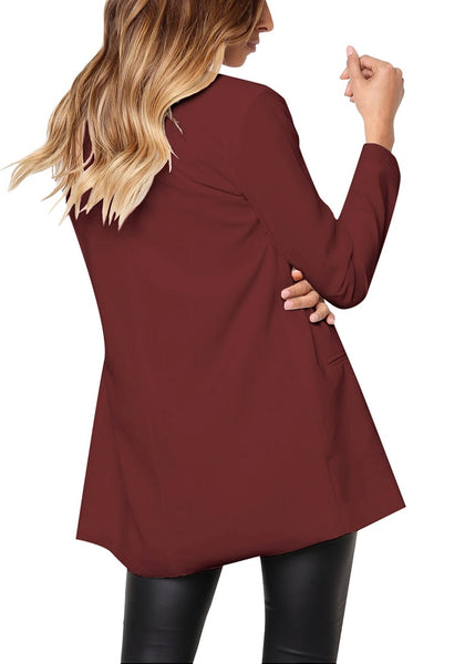 Back view of model wearing burgundy mock-pocket double-breasted lapel blazer