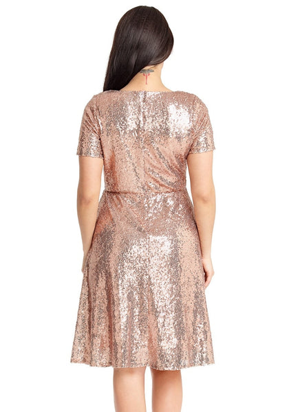 Back view of model wearing champagne sequined short sleeves skater dress