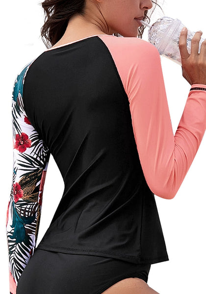 Back view of model wearing coral patchwork raglan sleeves round neck rash guard