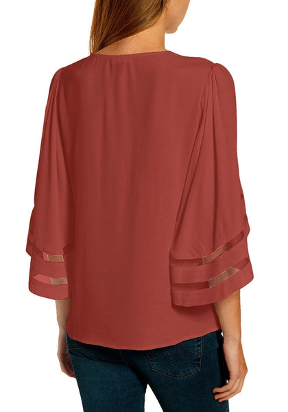 Back view of model wearing coral pink 34 bell mesh panel sleeves V-neckline front twist knot loose top