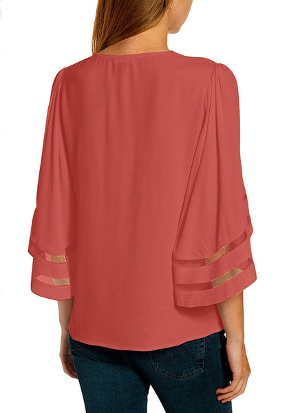 Back view of model wearing coral pink 34 bell mesh panel sleeves V-neckline loose top