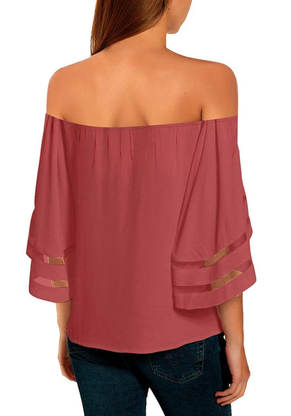 Back view of model wearing coral pink 34 bell mesh panel sleeves tie-front off-shoulder top