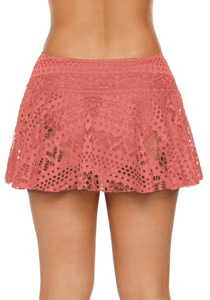 Back view of model wearing coral pink lace crochet swim skirt