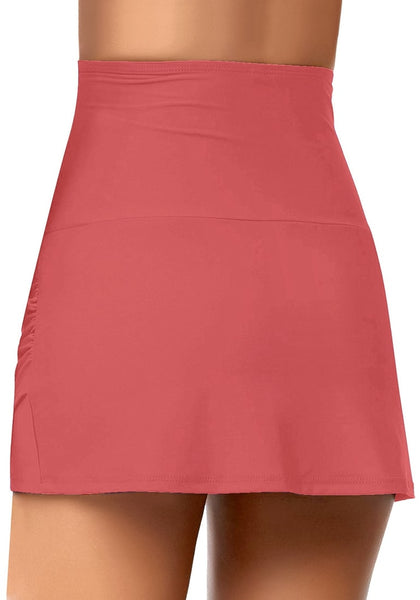 Back view of model wearing coral tulip hem high waist ruched swim skirt